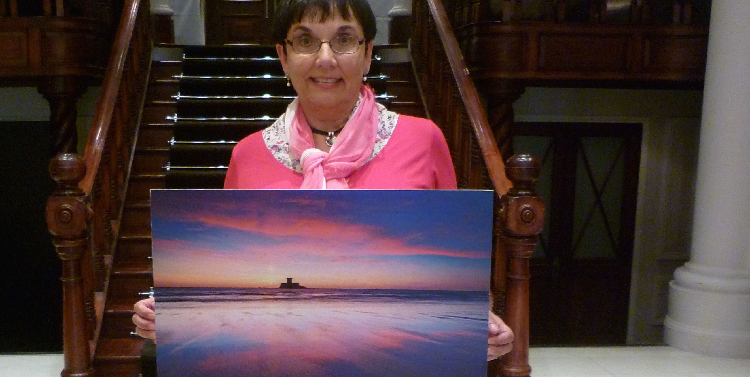 Sue Baudains with her photo